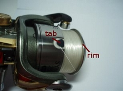 How to load line on a spinning reel global fishing tackle for Tying fishing line to reel